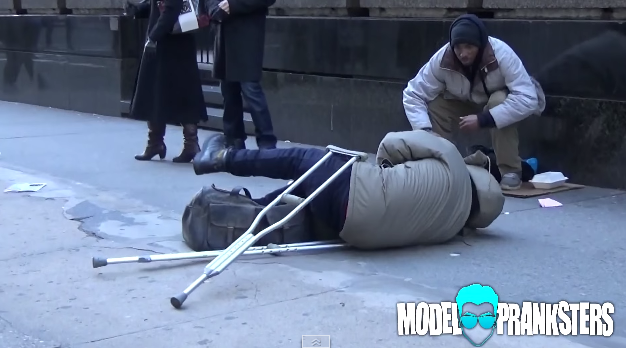 What would you do if you saw a man on crutches fall down on the sidewalk?